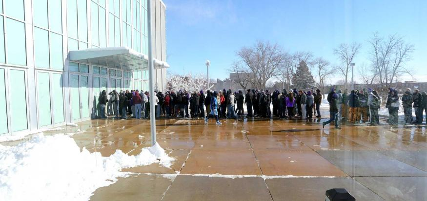 Students Waiting in Line Outside During Winter Weather.
