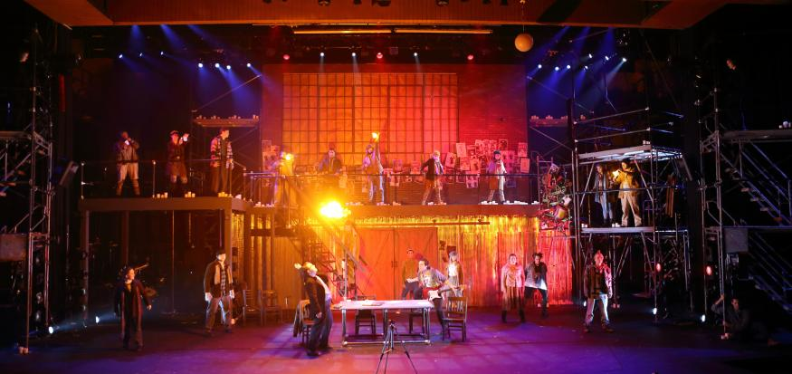 UNI Production of Rent with Flame on Stage
